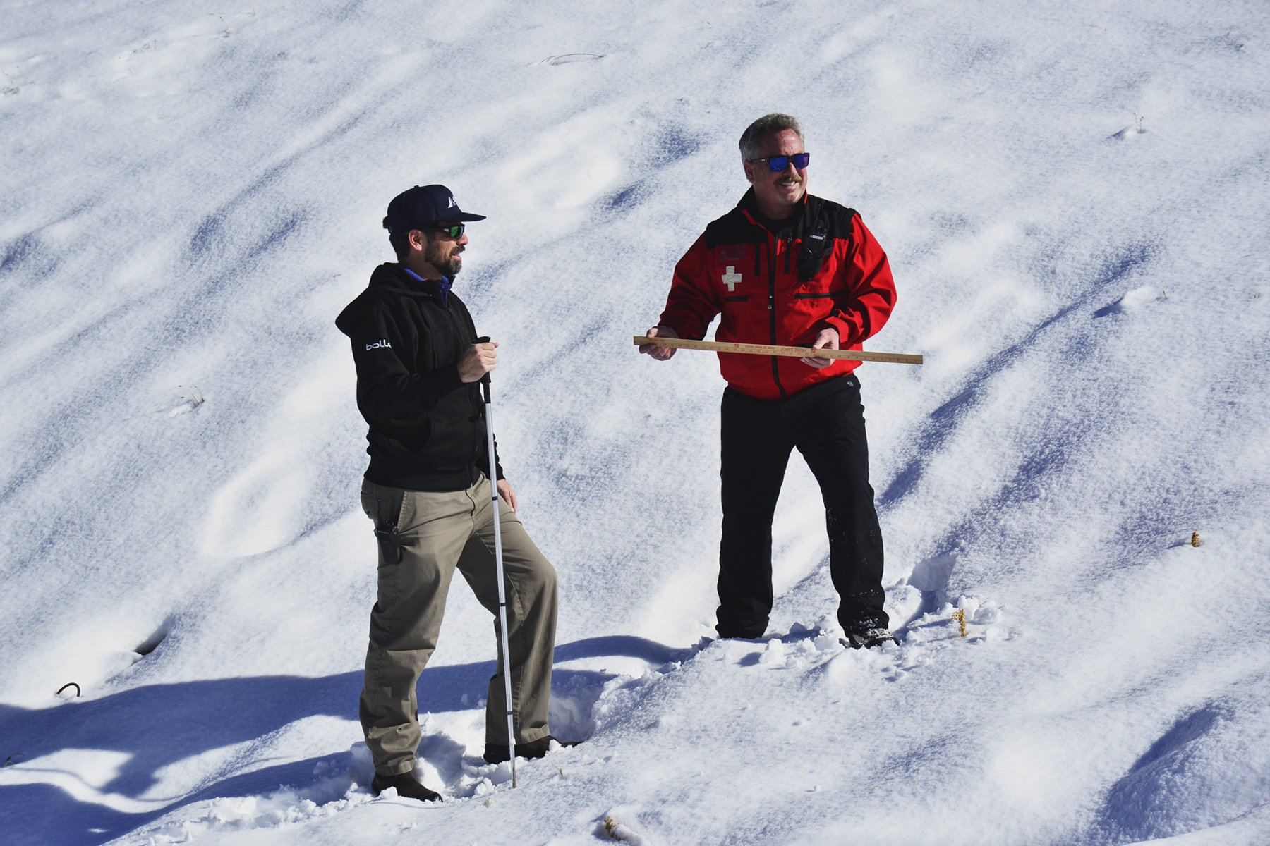 Two Snow Valley employees measuring fresh snowfall