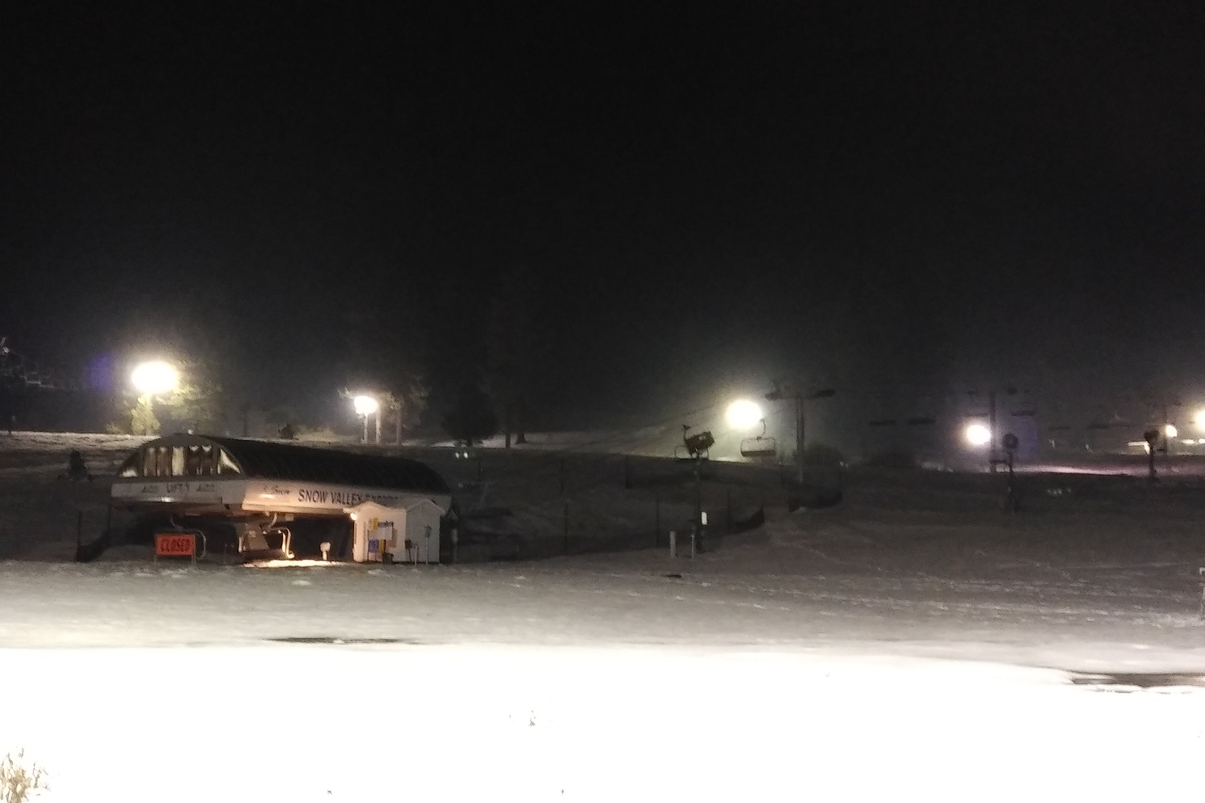 Lights illuminate the slopes during nighttime