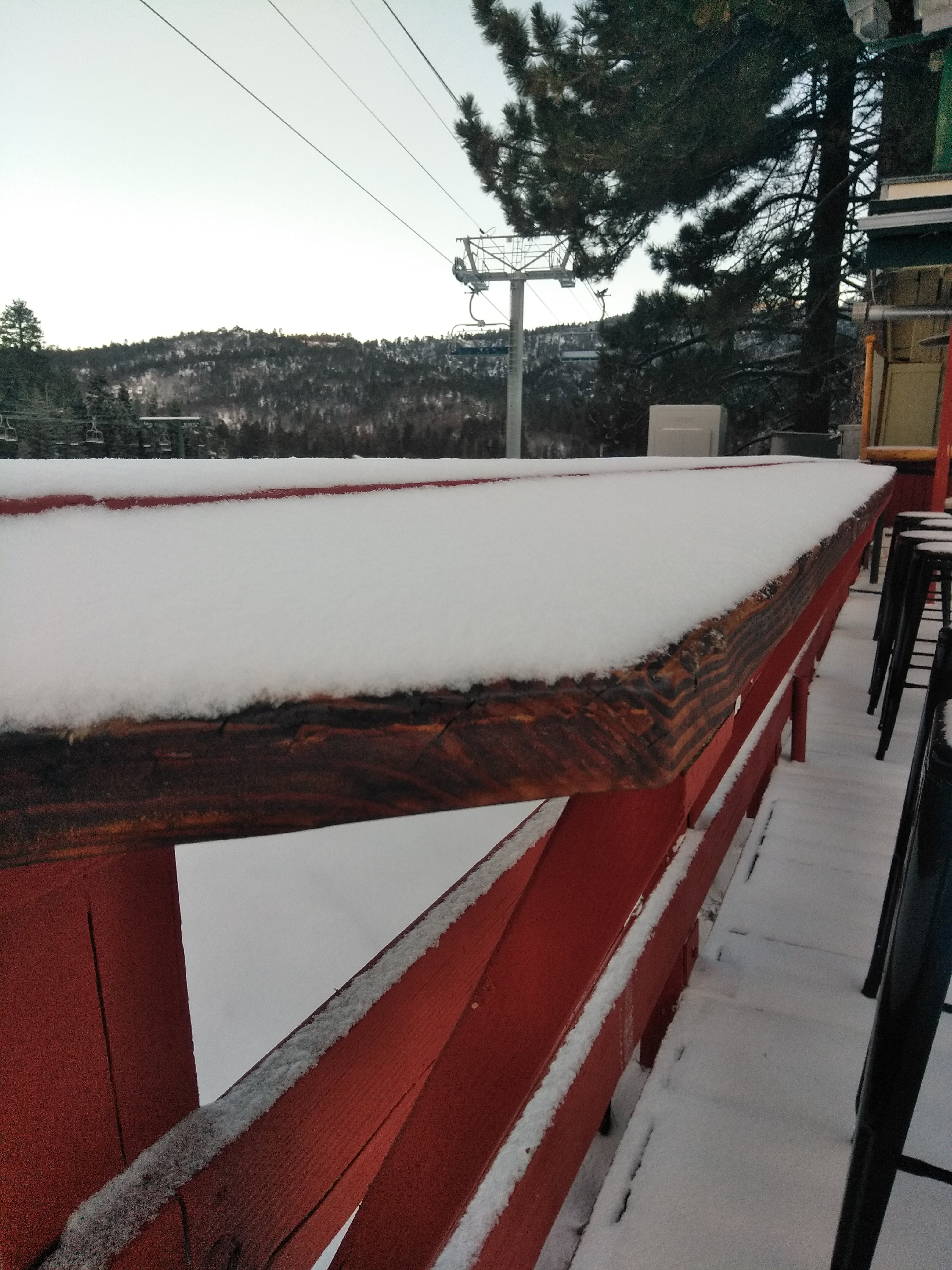 Snow Valley outdoor eating bar covered in snow after storm
