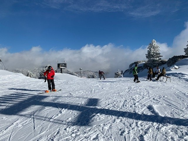 Snowboarders preparing to head down the slopes!