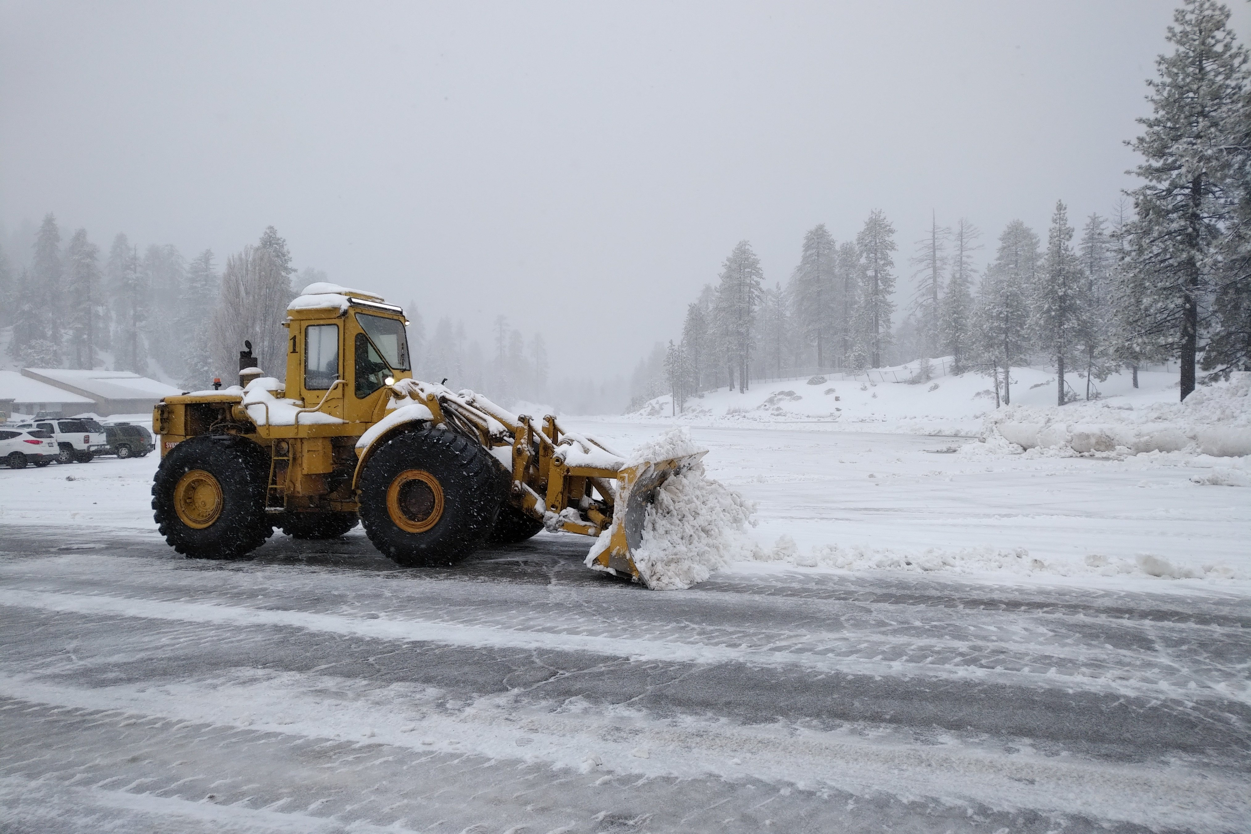Tractor plowing Snow Valley parking lot