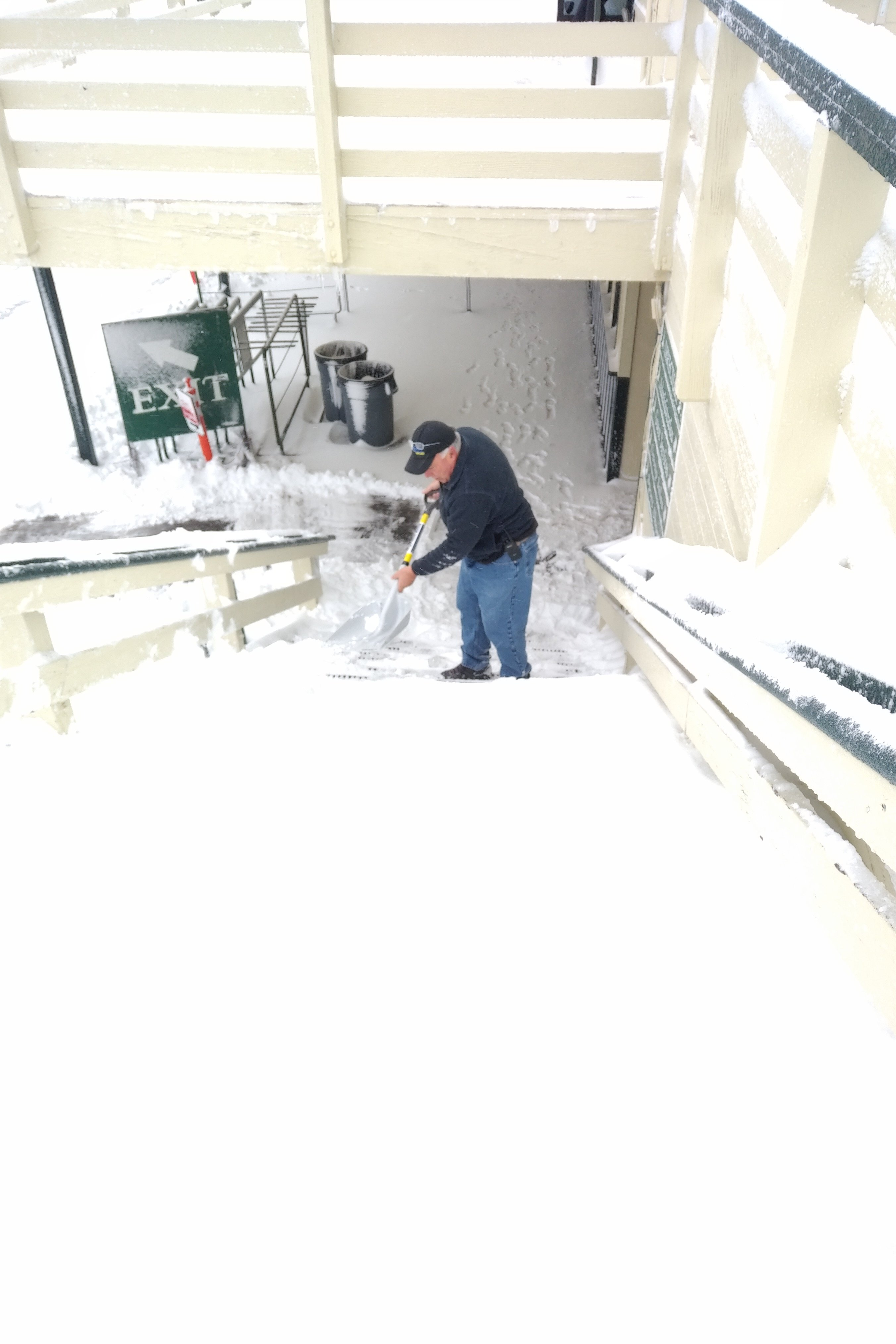 Snow Valley employee shoveling stairs