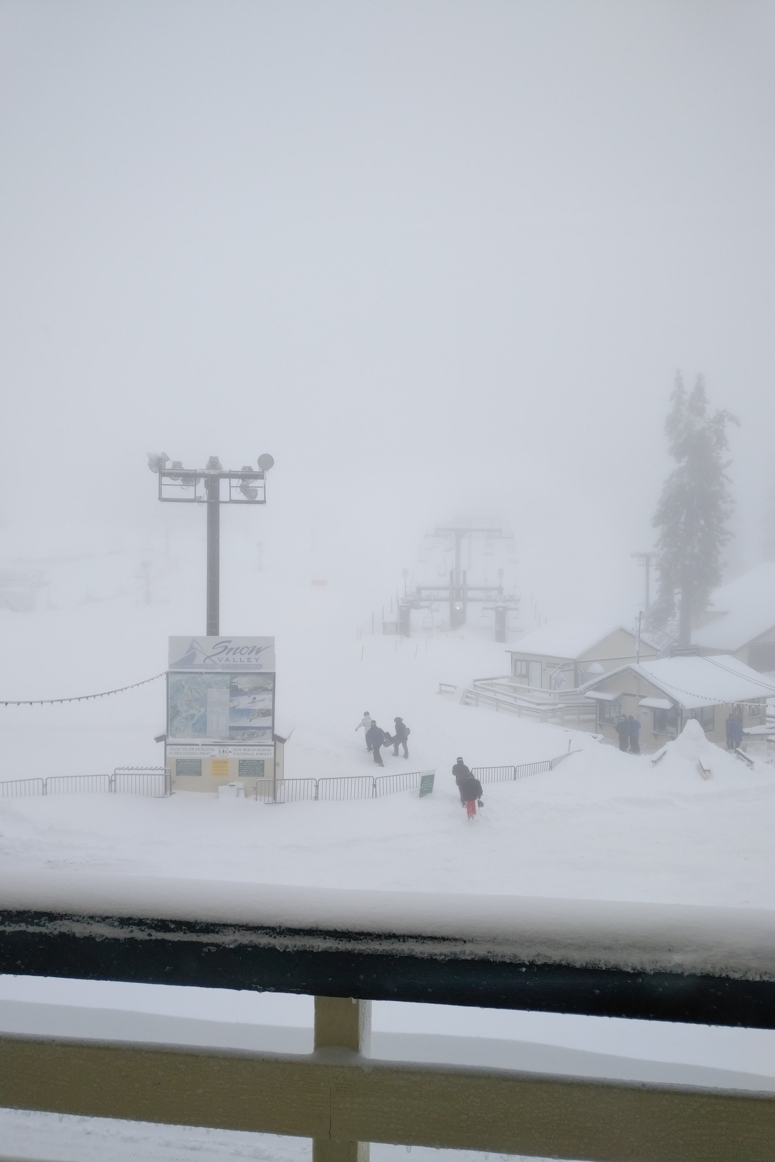 View of ski lifts in snowy conditions